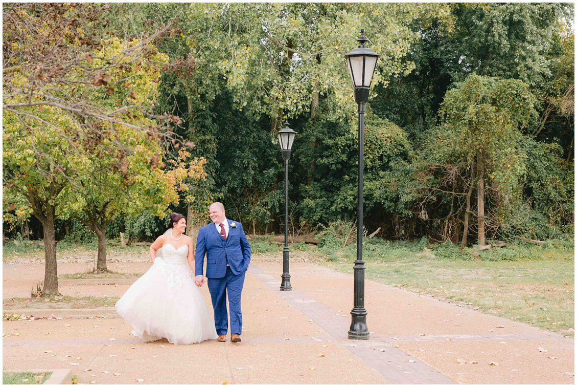Bride & Groom walking in St Charles Missouri after their industrial, fall wedding captured by Pattengale Photography