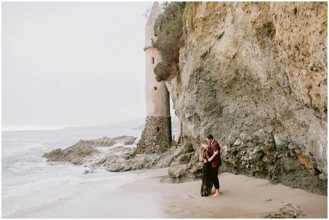 An adventurous romantic engagement session at Pirates Tower Victoria Beach in Laguna Beach California by Pattengale Photography