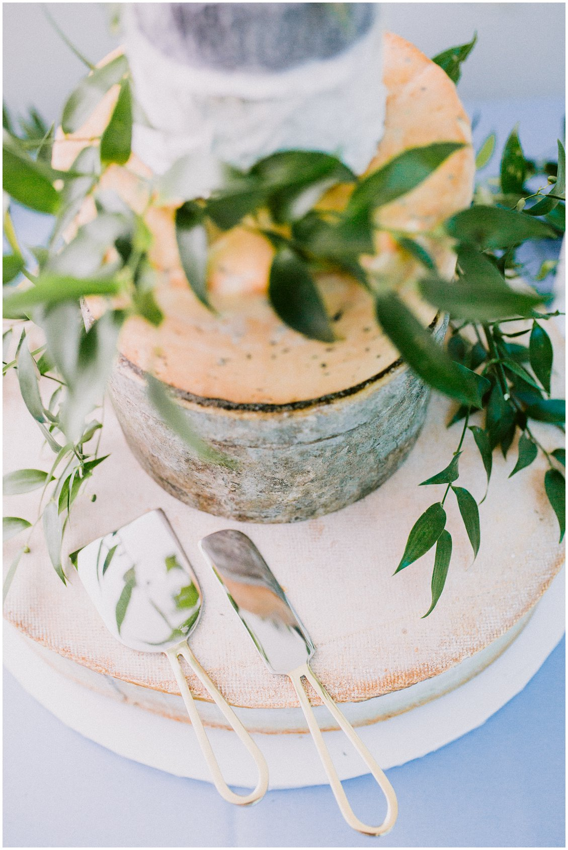 Wedding cake alternative cheese wheel cake at a summertime wedding at The Boocat Club and Graham Chapel on WashU Campus in St Louis Missouri by Pattengale Photography