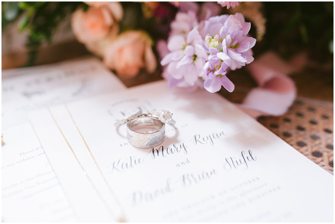 Wedding rings and soft florals on bespoke wedding invitations at Seven Springs Farm & Manor in Richmond VA
