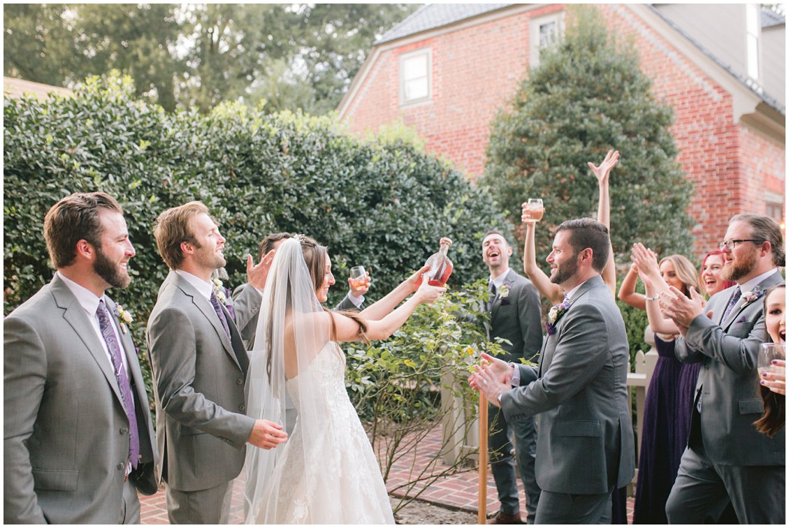 Digging up Bourbon at small outdoor wedding at Seven Springs Farm & Manor by Tara & Stephen of Pattengale Photography