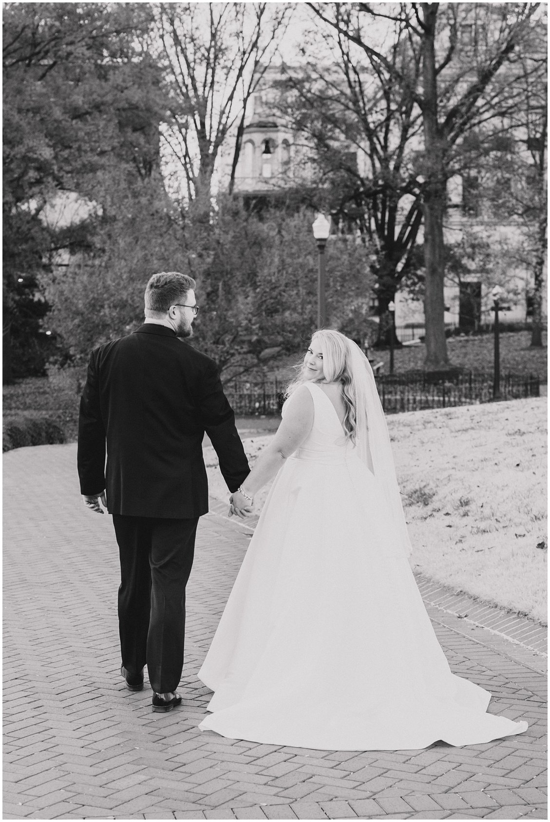 Black & White romantic photo of Bride and Groom in downtown Richmond, Virginia captured by Tara & Stephen - a husband and wife photography team